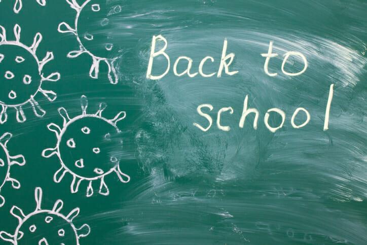 writing on a green chalkboard - back to school